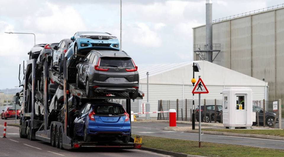 A car transporter loaded with Honda vehicles is driven in to the Honda manufacturing plant in Swindon, southwest England on February 19, 2019.