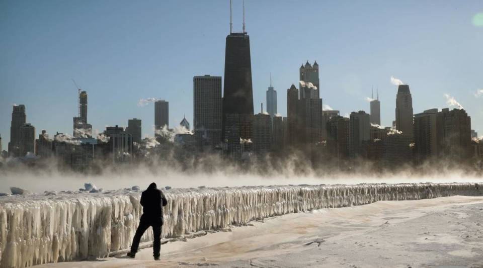A man takes a picture along the lakefront as temperatures hovered around -20 degrees on January 30, 2019 in Chicago, Illinois.