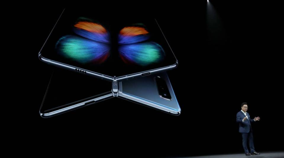 DJ Koh, President and CEO of IT & Mobile Communications Division of Samsung Electronics, announces the new Samsung Galaxy Fold smartphone during the Samsung Unpacked event on February 20, 2019 in San Francisco, California.