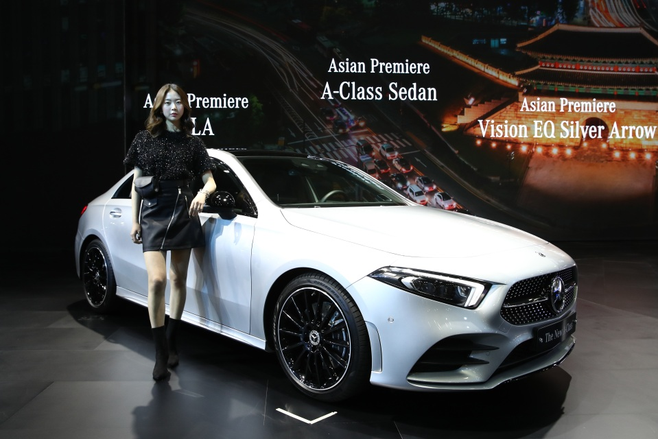A model poses next to a Mercedes-Benz New A Class at the Seoul Motor Show 2019 at KINTEX on March 28, 2019 in Goyang, South Korea.
