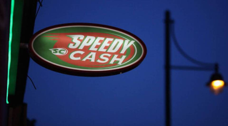 "A sign outside a ""Speedy Cash"" cash loans shop on Brixton High Street on Nov. 1, 2012 in London, England."