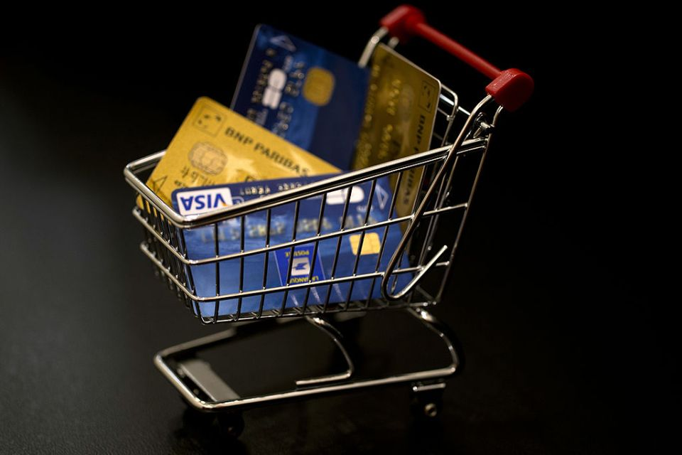 This illustration photo taken on December 22, 2012, in Paris, shows credit cards in a miniature toy shopping cart.