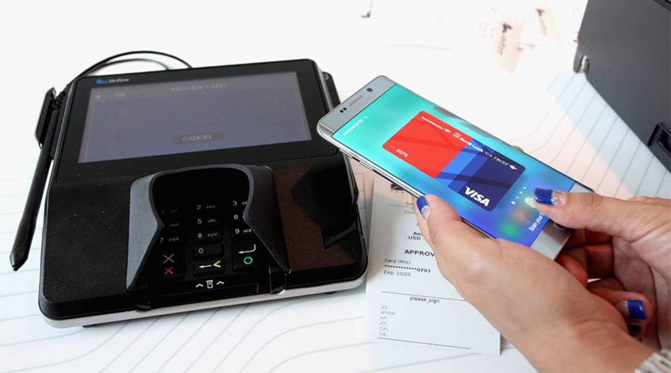 Guests demo Samsung Pay at Samsung Unpacked in 2015 in New York City.