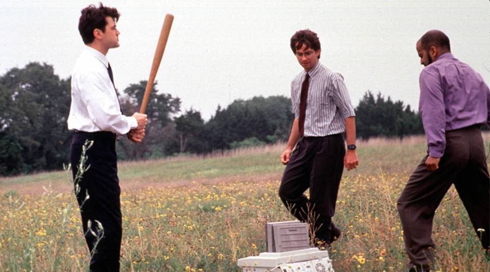 """Ron Livingston, David Herman and Ajay Naidu take revenge on their nemesis, the office fax machine, in a scene from the 1999 movie """"Office Space."""""""