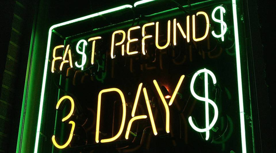 A neon sign is seen in a window of a tax preparation office in Des Plaines, Illinois.