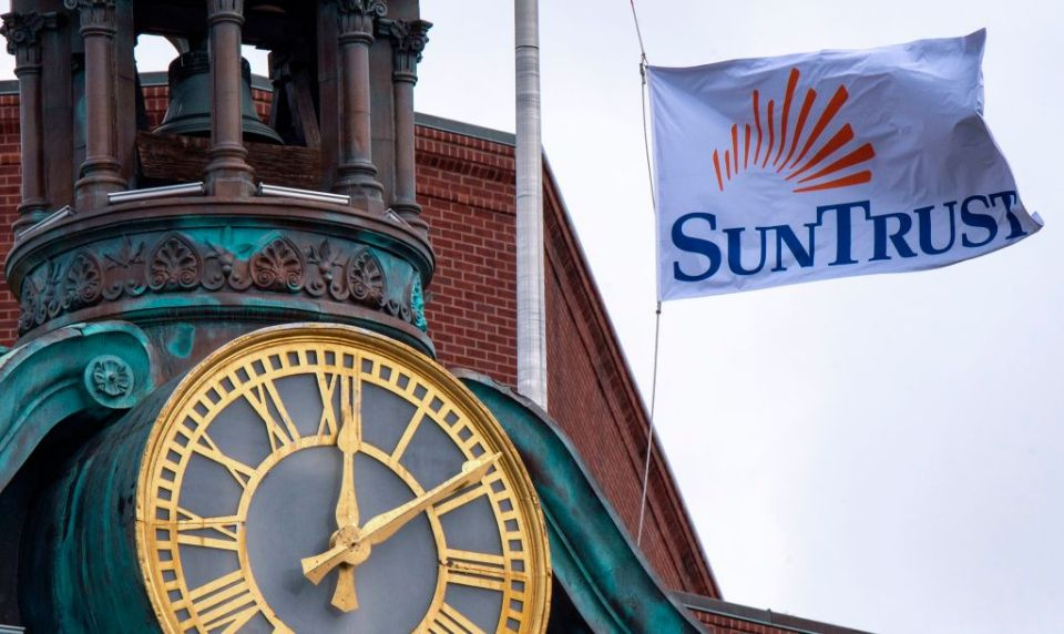 A Sun Trust bank flag flies above their bank in downtown Washington, DC.