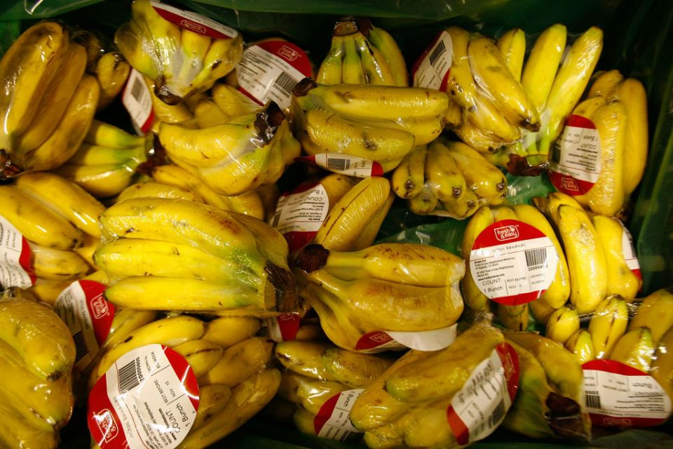 Pre-packaged bananas are shown for sale at a Fresh & Easy grocery as Tesco PLC, the UK's biggest retailer, officially enters the U.S. market, opening its first six stores in southern California on November 8, 2007 in Los Angeles, California. Tesco is importing its own system of grocery store operations, making heavy use of pre-packaged produce, in contrast to U.S.-based grocery chains, to reduce overhead and refrigeration costs. The Fresh & Easy markets, which are significantly smaller than typical U.S. supermarkets,  will use its own truck fleet for single deliveries from a centralized distribution center. The chain will operate from a relatively small $10,000 per square foot, producing more than a projected $200,000 a week, twice that per square foot of typical U.S. food stores .