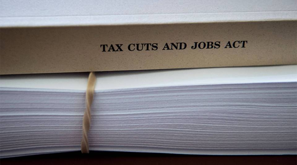 Documents stack up before a hearing of the House Rule Committee on tax reform legislation on Dec. 18, 2017, in Washington, D.C.
