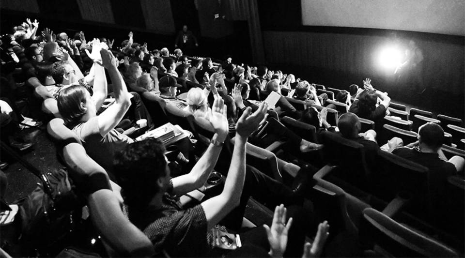 """The audience claps during a screening of the 1952 film """"Park Row"""" at the 2018 TCM Classic Film Festival in Hollywood, California."""