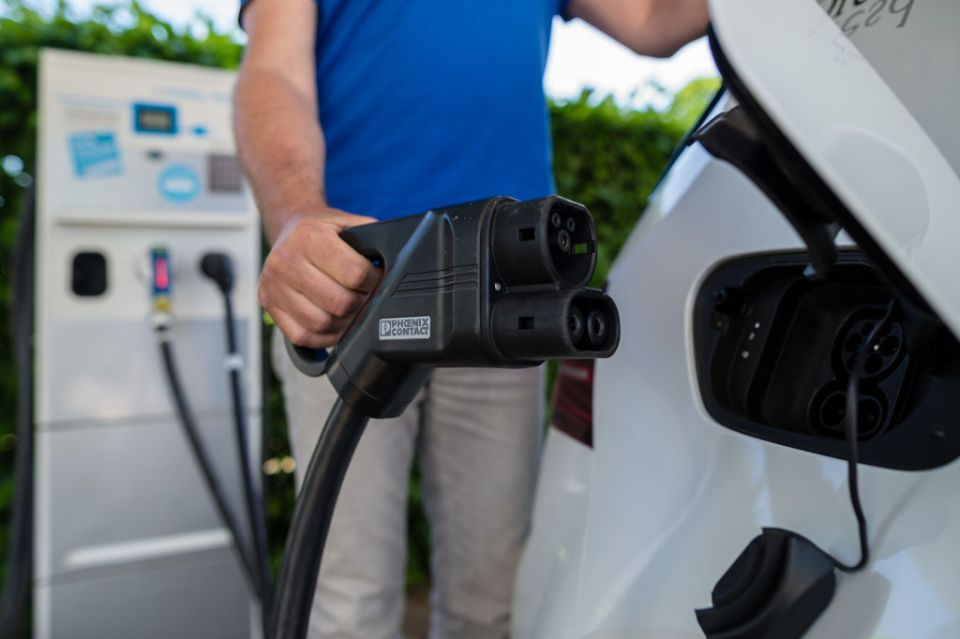 Charging plugs sit connected to a Volkswagen e-Golf electric automobile to an electric charging station outside the Volkswagen AG (VW) factory on May 8, 2018 in Dresden, Germany.