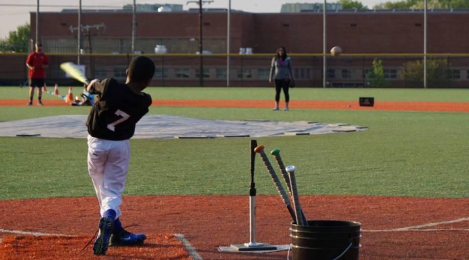 A boy bats during baseball practice at the Nationals Youth Baseball Academy in Washington, DC, on May 7, 2018.
