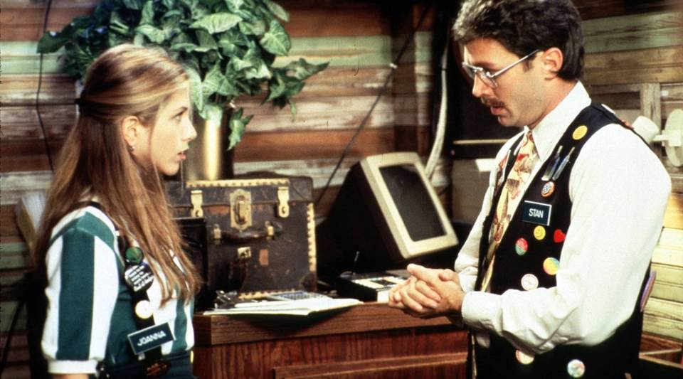 """Waitress Joanna (Jennifer Aniston) has a talk with her boss (Mike Judge) in """"Office Space."""""""