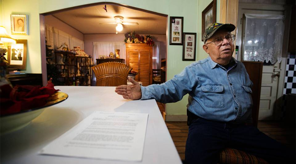 Rey Anzaldua, 73, sits in his cousin Fred's dining room on Thursday, Jan. 31 2019, mulling over documents the federal government has sent the family seeking permission to build a wall on their land. He says the family will never sign over the rights and the government will have to take the land through eminent domain if a wall is going to be built on their property.
