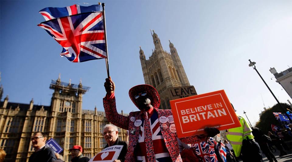 Pro-Brexit activists march outside the Houses of Parliament in central London on February 27, 2019.