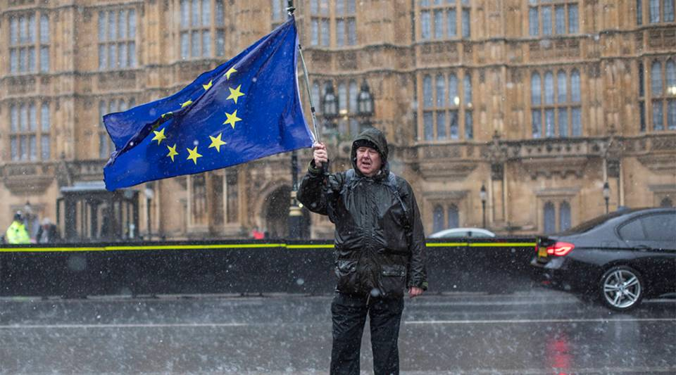 Anti Brexit demonstrators protest in the rain on March 12, 2019 in London, England.