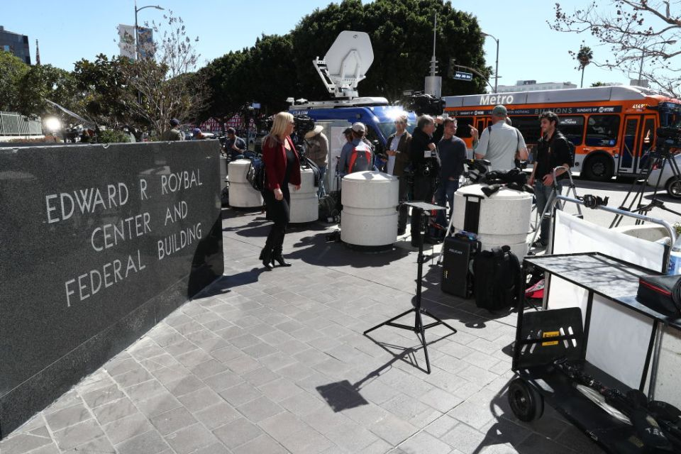 The media is seen outside the Edward R. Roybal Federal Building and United States Courthouse on March 13, 2019 in Los Angeles, California.  Actors Felicity Huffman, Lori Loughlin and designer Mossimo Giannulli are among 50 people charged in a college admission cheating scheme that involves bribery and fraud in attempts to get students recruited as athletes and help them cheat on exams.
