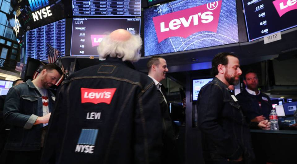 Traders, many in jeans, work on the floor of the New York Stock Exchange on the day that Levi Strauss has returned to the stock market with an IPO on March 21, 2019 in New York City.