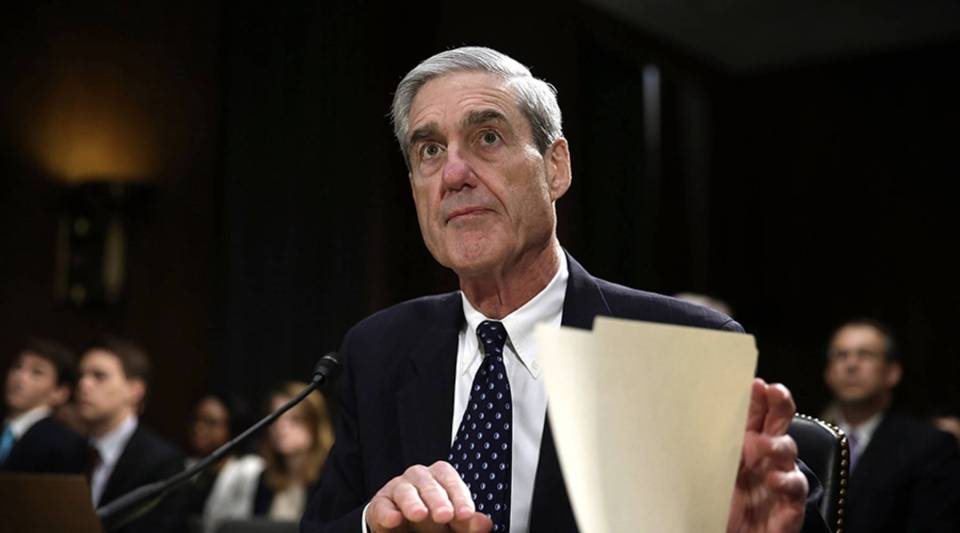 Then-FBI Director Robert Mueller waits for the beginning of a hearing before the Senate Judiciary Committee June 19, 2013, on Capitol Hill in Washington, D.C.