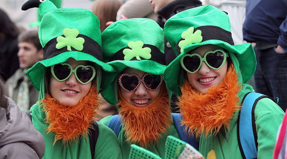 Spectators dressed as leprechauns attend St. Patrick's Day parade in Dublin on March 17, 2014.