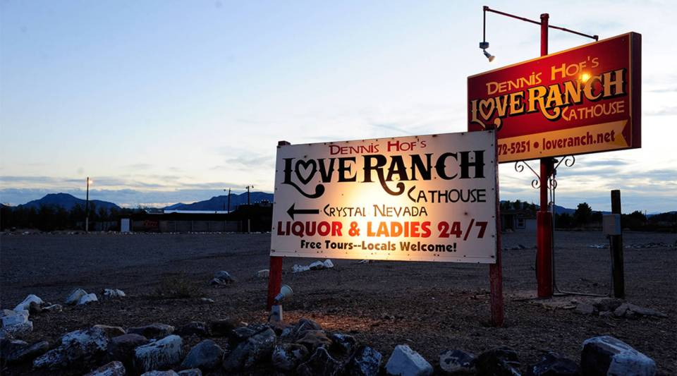 Signs for the Love Ranch Las Vegas brothel in Crystal, Nevada.
