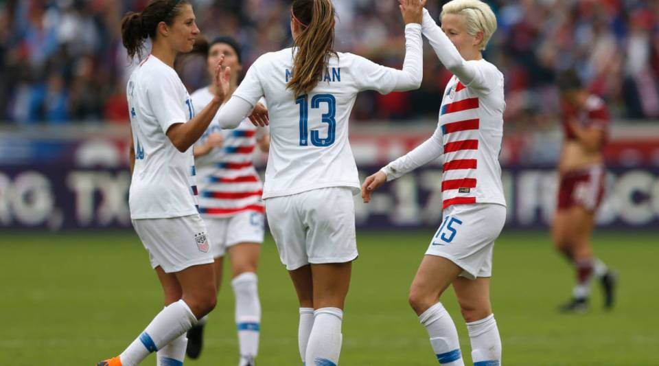 Alex Morgan #13 of United States and Carli Lloyd congratulate Megan Rapinoe #15 after a goal in the second half against the Mexico at BBVA Compass Stadium on April 8, 2018 in Houston, Texas.