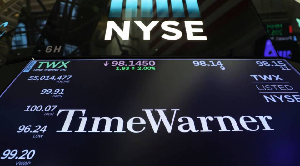 The logo and trading information for Time Warner is displayed on a monitor on the floor of the New York Stock Exchange (NYSE) June 13, 2018 in New York City.