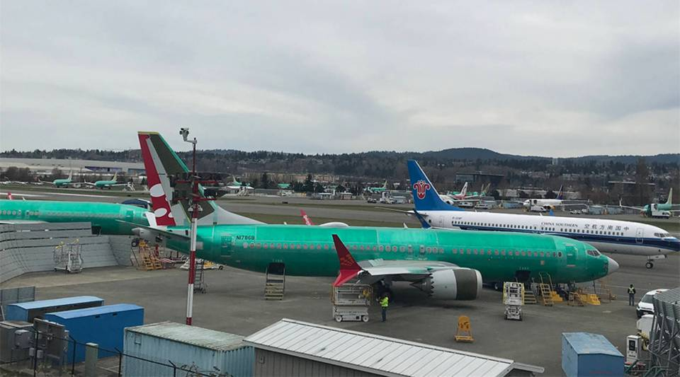 Boeing's 737 assembly complex in Renton, Washington, is a hive of activity. In the foreground, a 737 Max is being painted. In the background, the brakes are tested on a new 737 Max for China Southern Airlines.