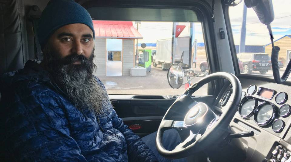 Mintu Pandher sits inside the cab of his rig at the truck stop he bought a few years ago in southeastern Wyoming. He joined the industry because it was a blue-collar job that didn't interfere with his Sikh beliefs and traditions.