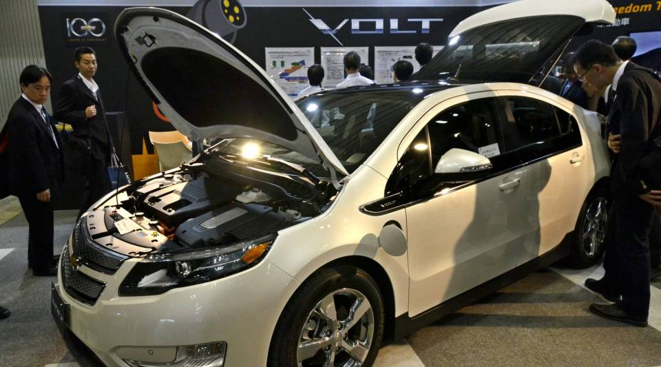 Visitors admire the Chevy Volt at the annual auto engineering exhibition in Yokohama, suburban Tokyo on May 19, 2011.