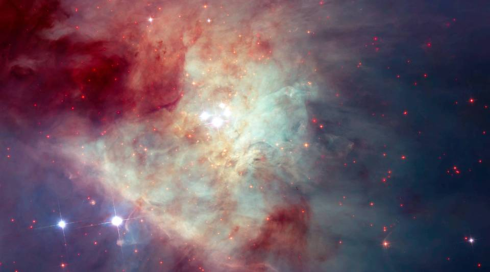 This composite image of the Kleinmann-Low Nebula, part of the Orion Nebula complex, is composed of several pointings of the NASA/ESA Hubble Space Telescope in optical and near-infrared light. Infrared light allows to peer through the dust of the nebula and to see the stars therein. The revealed stars are shown with a bright red colour in the image.