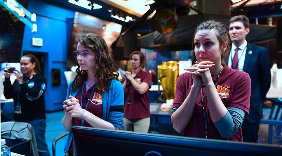 Employees at NASA's Jet Propulsion Laboratory in Pasadena, California, watch the landing of InSight on Mars on Nov. 26, 2018.