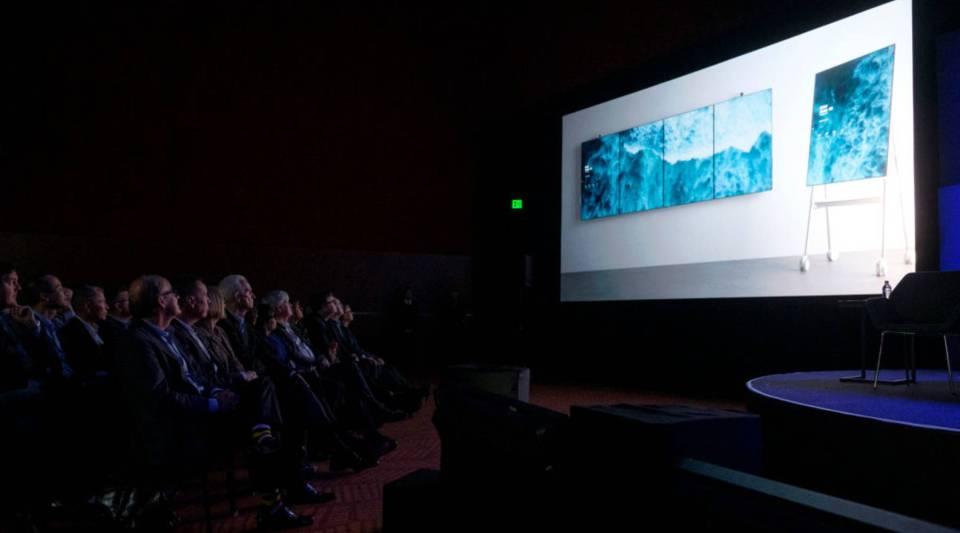 Board members watch a video demonstration for the Surface Hub 2 during the Microsoft annual shareholders meeting in Bellevue, Washington, in 2018.
