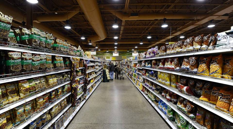 People shop at Wegmans Foods store in Fairfax, Virginia, on February 24, 2011.
