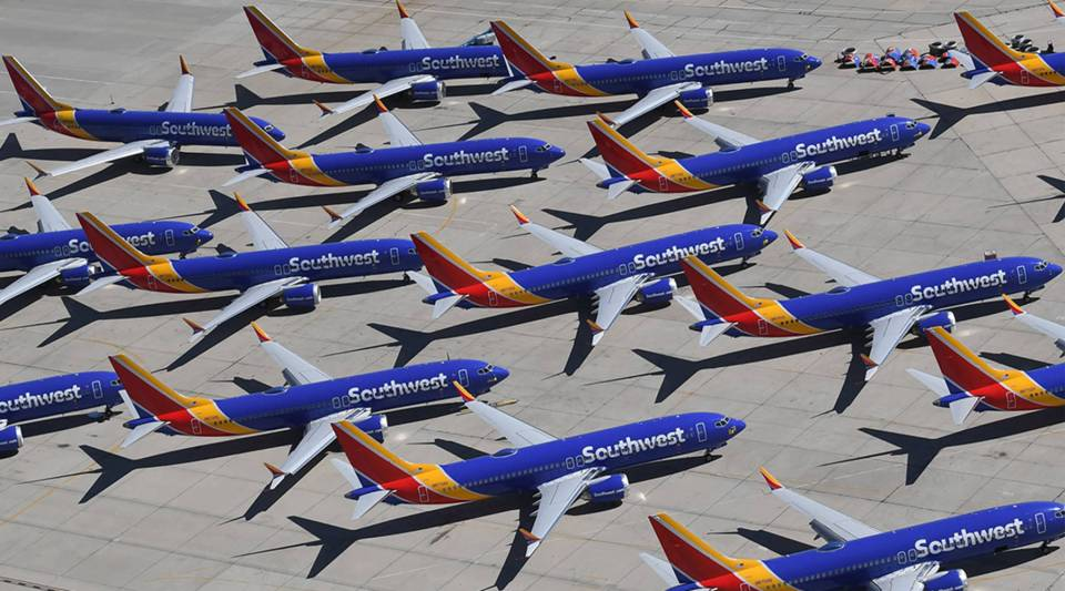 Southwest Airlines Boeing 737 Max airplanes are parked on the tarmac after being grounded at the Southern California Logistics Airport in Victorville on March 28.