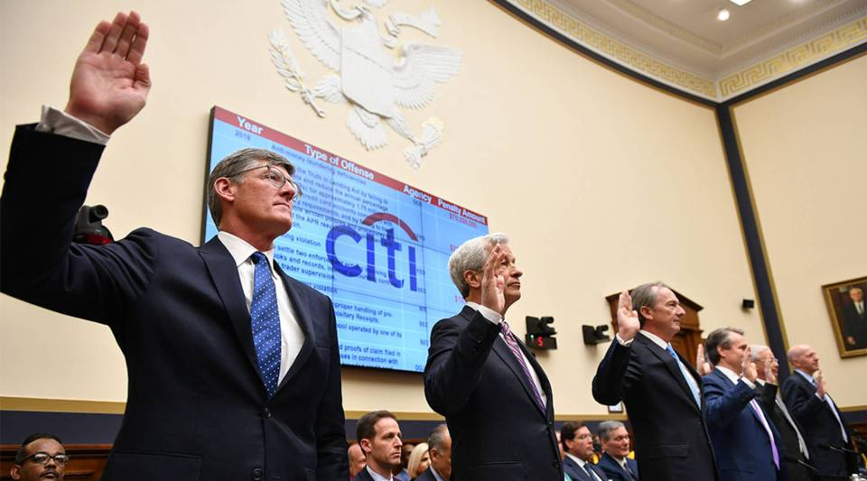 CEO of Citigroup, Michael Corbat (L), chairman and chief executive of JPMorgan Chase, Jamie Dimon (2ndL) and others are sworn in to testify before the House Financial Services Committee on accountability for mega banks on Capitol Hill in Washington, DC on April 10, 2019.