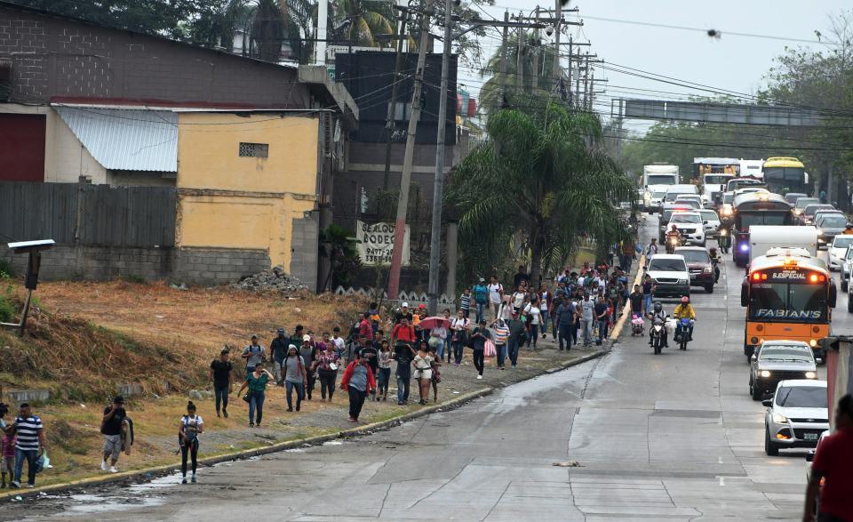 Honduran migrants leave the Metropolitan Center of San Pedro Sula, 300 kms north of Tegucigalpa, to travel to the Guatemala border.