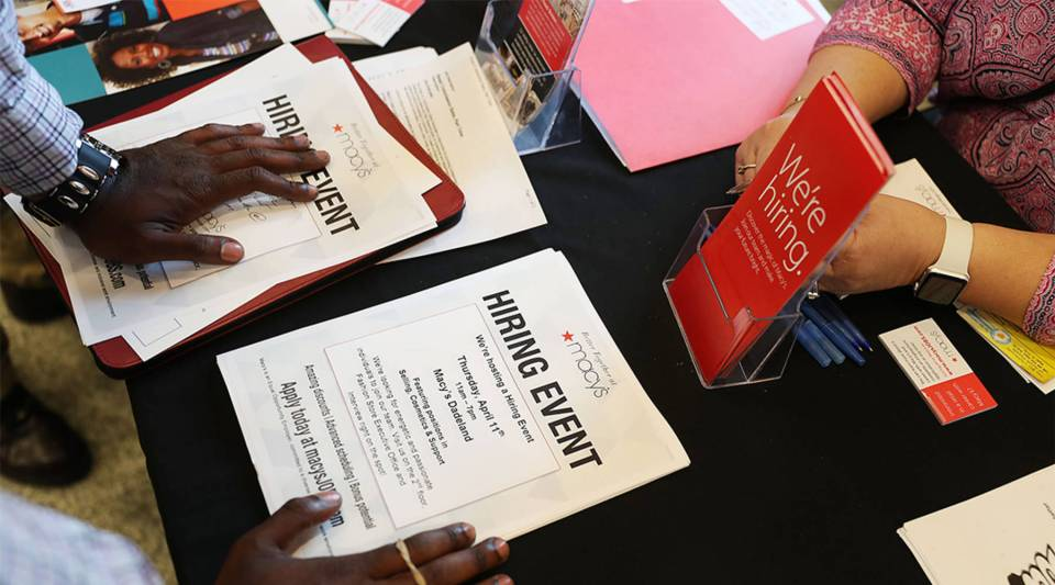 Job hiring paperwork is seen on a deskduring a job fair put on by Miami-Dade County and other sponsors on April 05, 2019 in Miami, Florida.The job fair was being held as the Labor Department released its monthly hiring and unemployment figures for March which showed that 196,000 jobs were added last month, a rebound from the February report.