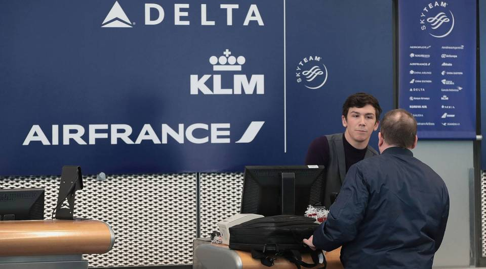 A passenger checks in for a flight at the Delta Air Lines desk at O'Hare International Airport in Chicago, Illinois. Delta Air Lines recently beat Wall Street's expectations reporting record first-quarter revenue.