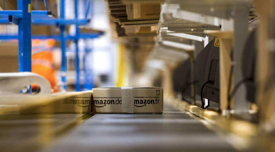 An Amazon package makes its way down a conveyor belt before being shipped.