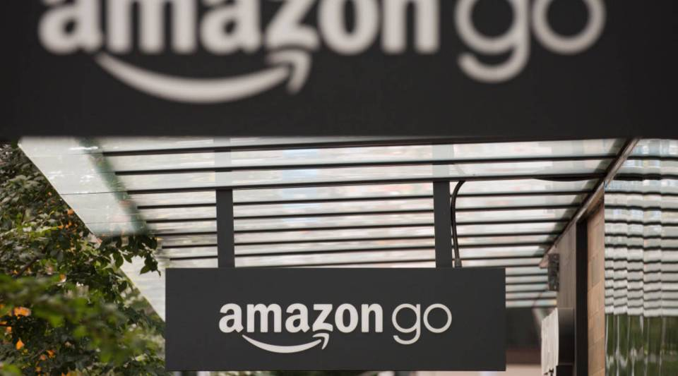 Signs for Amazon Go are seen outside the grocery store's location on June 16, 2017 in Seattle, Washington.