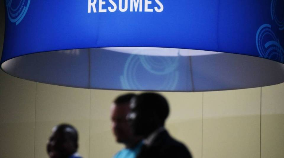 Job seekers arrive at the Walter E. Washington Convention Center for The Opportunity Hiring Fair in Washington, DC, on September 20, 2017.