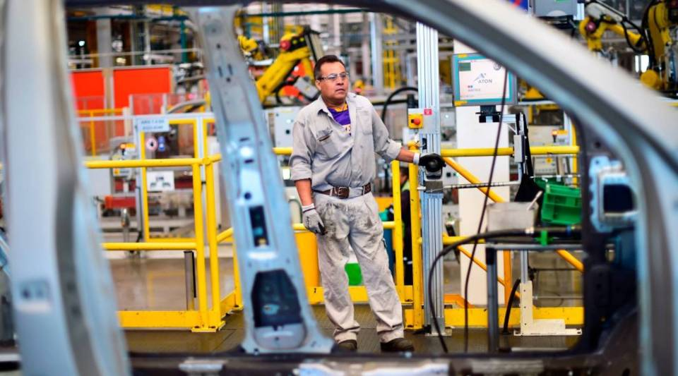 Employees work on the assembly line of the Tiguan model, at the Volkswagen car plant in Puebla, central Mexico, on March 16, 2018.