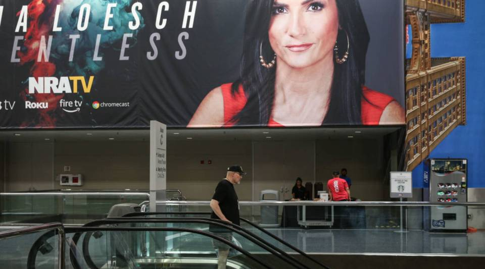 A photo of National Rife Association spokesperson Dana Loesch decorates a wall at the Kay Bailey Hutchison Convention Center during the NRA's annual convention May 6, 2018 in Dallas, Texas.