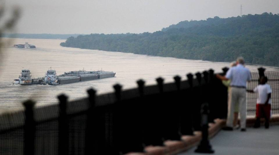 A barge moves along the flooded Mississippi River in 2011 in Natchez, Mississippi.
