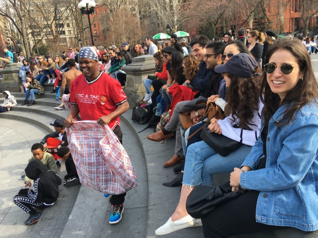 Break dancer Tyheem Barnes makes the rounds collecting cash donations from the audience in Washington Square Park. He and his twin brother Kareem also collect tips on Cash App and Venmo.