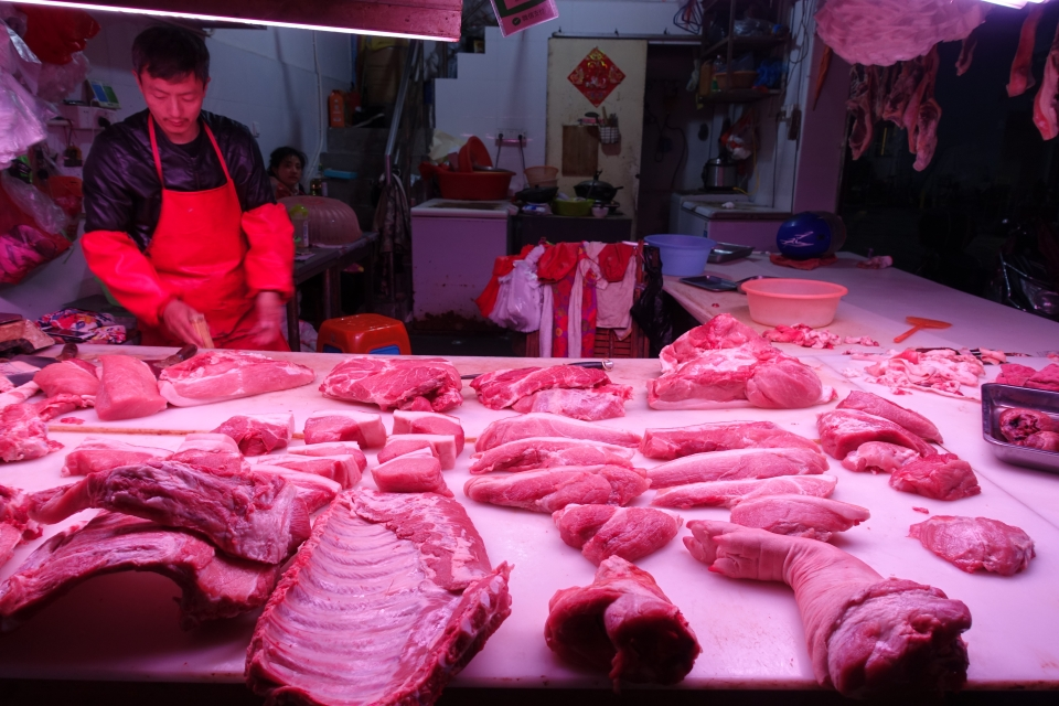 A local meat market in Shanghai is dominated by pork stands. Pork is a staple in the Chinese diet and accounts for 70% of all meat consumed in China.