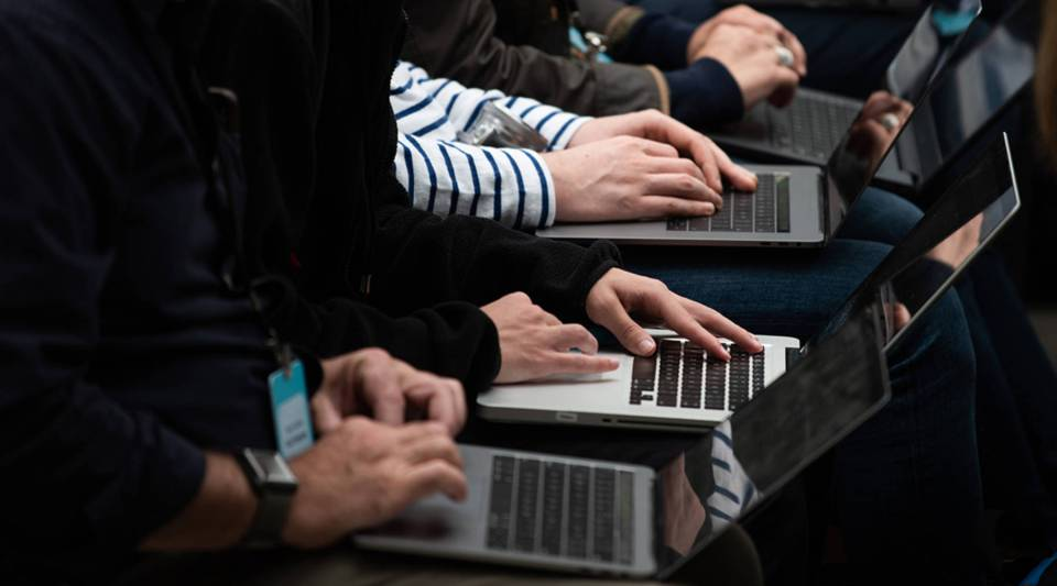 Tech workers use laptops during an Amazon event in Seattle, Washington on September 20, 2018.