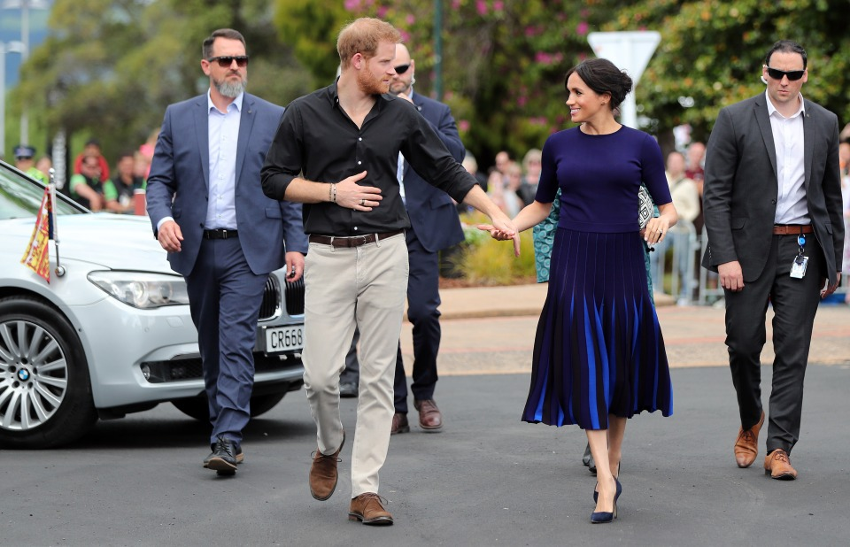 In this file photo taken on October 31, 2018 Britain's Prince Harry and Meghan, Duchess of Sussex arrive for a public walkabout at the Rotorua Government Gardens in Rotorua, New Zealand.
