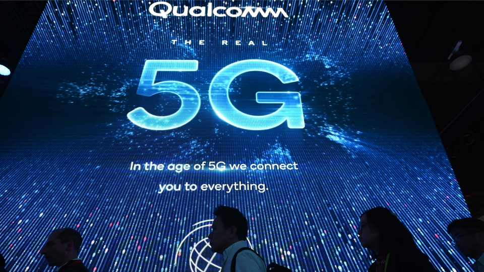 Attendees wait in line for a 5G exhibition at the Qualcomm booth during CES 2019 consumer electronics show, on January 10, 2019 at the Las Vegas Convention Center in Las Vegas, Nevada.
