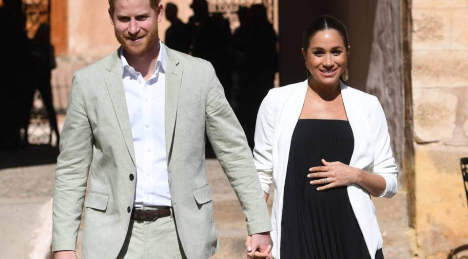 Prince Harry, Duke of Sussex and Meghan, Duchess of Sussex walk through the walled public Andalusian Gardens which has exotic plants, flowers and fruit trees during a visit on February 25, 2019 in Rabat, Morocco.